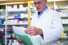 Pharmacist reading prescriptions Royalty Free Stock Photography