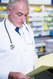 Pharmacist reading prescriptions Stock Images