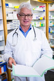 Pharmacist reading prescriptions Stock Photography