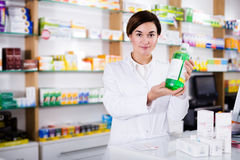 Pharmacist ready to assist in choosing at counter Royalty Free Stock Image