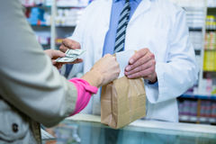 Pharmacist receiving payment from customer Stock Images