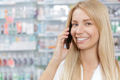 Pharmacist receiving prescription by mobile phone Royalty Free Stock Images