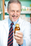 Pharmacist recommending a product royalty free stock photo