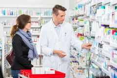 Pharmacist Removing Medicine For Customer Royalty Free Stock Photo