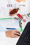 Pharmacist's hands at work Stock Photo