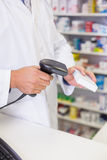 Pharmacist scanning medicines Royalty Free Stock Images