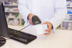 Pharmacist scanning medicines Stock Image