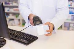 Pharmacist scanning medicines Stock Image
