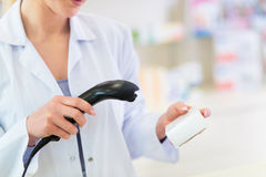 Pharmacist scanning product Stock Photography