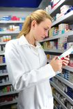 Pharmacist searching Royalty Free Stock Images