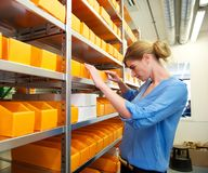 Pharmacist searching for medicine and prescriptions Stock Photos