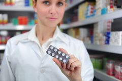 Pharmacist selling medicine. At the pharmacy royalty free stock photography