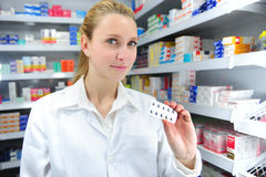 Pharmacist selling medicine. To a client at the pharmacy Royalty Free Stock Image