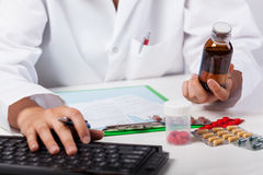 Pharmacist selling syrup Stock Photo