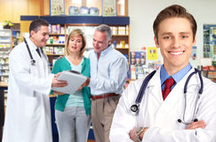 Pharmacist with a senior couple. Royalty Free Stock Images