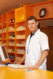 Pharmacist serving behind counter Stock Photography