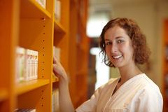 Pharmacist at shelf Royalty Free Stock Images