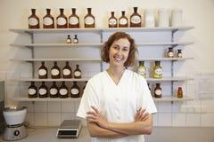 Pharmacist with shelf Stock Photos