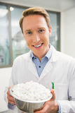 Pharmacist showing bowl of pills Royalty Free Stock Photography