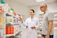 Free Pharmacist Showing Drug To Senior Man At Pharmacy Stock Photo - 78260110