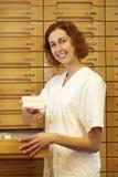 Pharmacist showing medication Royalty Free Stock Photo