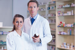 Pharmacist showing medication to his trainee Stock Photography