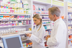 Pharmacist showing medication to his trainee Stock Image