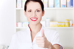 Pharmacist showing okay gesture. Stock Photos
