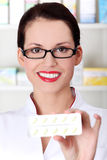 Pharmacist showing pill blister. Royalty Free Stock Photography