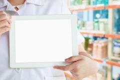Pharmacist showing tablet computer with the pharmacy store Royalty Free Stock Photos
