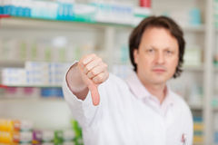 Pharmacist showing thumbs down Stock Image