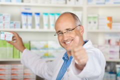 Pharmacist showing thumbs up Royalty Free Stock Image