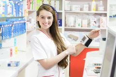 Pharmacist showing a tonometer Stock Photography