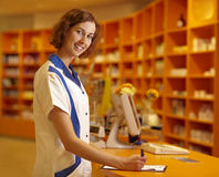 Pharmacist signing contract Royalty Free Stock Photos