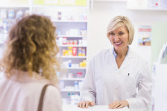 Pharmacist smiling at costumer Stock Image