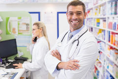 Pharmacist smiling with Pharmacist on the phone Royalty Free Stock Images