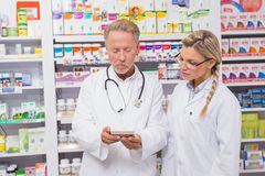 Pharmacist speaking with his trainee about medicine Royalty Free Stock Photo