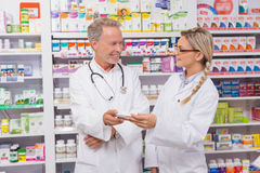 Pharmacist speaking with his trainee about medicine Royalty Free Stock Image