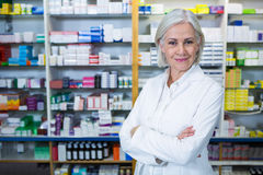 Pharmacist standing with arms crossed. Portrait of pharmacist standing with arms crossed in pharmacy royalty free stock photo