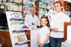 Pharmacist standing with a cash desk Stock Images
