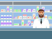 Pharmacist standing near shelves with medications Royalty Free Stock Images