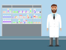 Pharmacist standing near shelves with medications Royalty Free Stock Photography