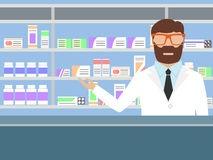 Pharmacist standing near shelves with medications Royalty Free Stock Photo