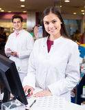 Pharmacist standing at pay desk Stock Photography
