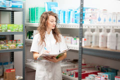 Pharmacist in the storage facility. Making an inspection. Healthcare business Royalty Free Stock Photos