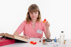 Pharmacist studying composition pills Stock Images