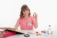 Pharmacist studying under directory properties of liquid in vial stock photography