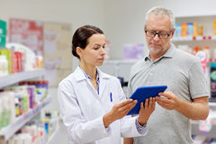 Pharmacist with tablet pc and senior man Royalty Free Stock Photography