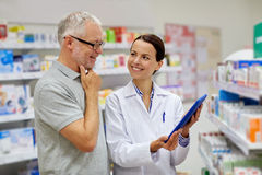 Pharmacist with tablet pc and senior man Stock Photo