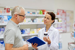 Pharmacist with tablet pc and senior man Royalty Free Stock Photo